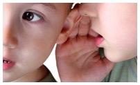 Kid whispering to ear